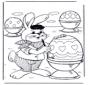 Osterhase malt Eier